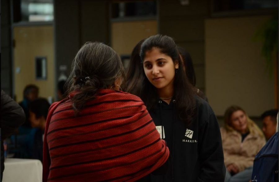 Sophomore Melody Yazdi talks with another attendee. The Diversity Committee originally came up with the idea of holding such a gathering at Harker after they were unable to secure spots at the Student Diversity Leadership Conference (SDLC) in Nashville last year.