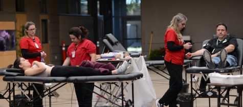 K-12 Production Manager Brian Larsen and Anna Arnaudova (11) prepare to have their blood drawn. Blood collected from Monday's blood drive will be sent to a Red Cross blood bank in Pomona, California to distribute to hospitals around the state.