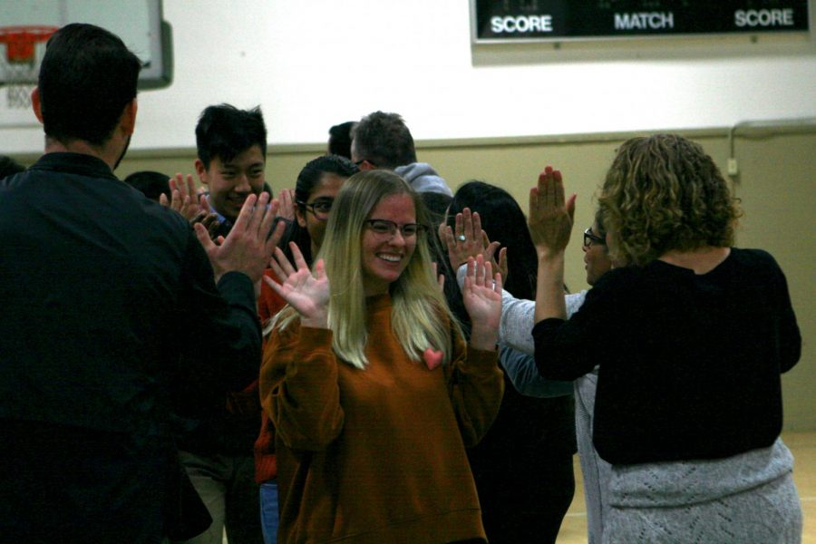 Geneva+Devlin+%2811%29+smiles+as+she+high+fives+upper+school+mathematics+teacher+Dr.+Lola+Muldrew.+After+a+faculty+meeting+from+8+to+8%3A30+a.m.%2C+students+arrived+in+the+auxiliary+gym.