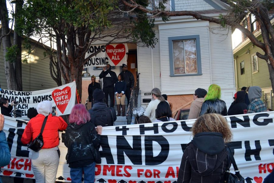 Supporters of Moms4Housing hold a rally outside of the disputed house on Jan. 14. The mothers reached an agreement with Wedgewood Properties, who agreed to sell the house to the Oakland Community Land Trust, a nonprofit that will rent the house to the mothers at an affordable price.