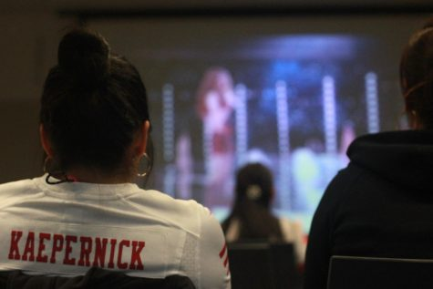 The organizer of the Super Bowl viewing party  at the Northside Branch Library, Cheryl Lee, watches Shakira perform during the halftime performance.