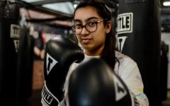 """[Kickboxing] really just helps me clear my mind ... It's kind of a way to step back and also burn off some pent-up stress. It's great to get exercise and build muscle, but it's also really stress-relieving,"" Maya Shukla (12) said."