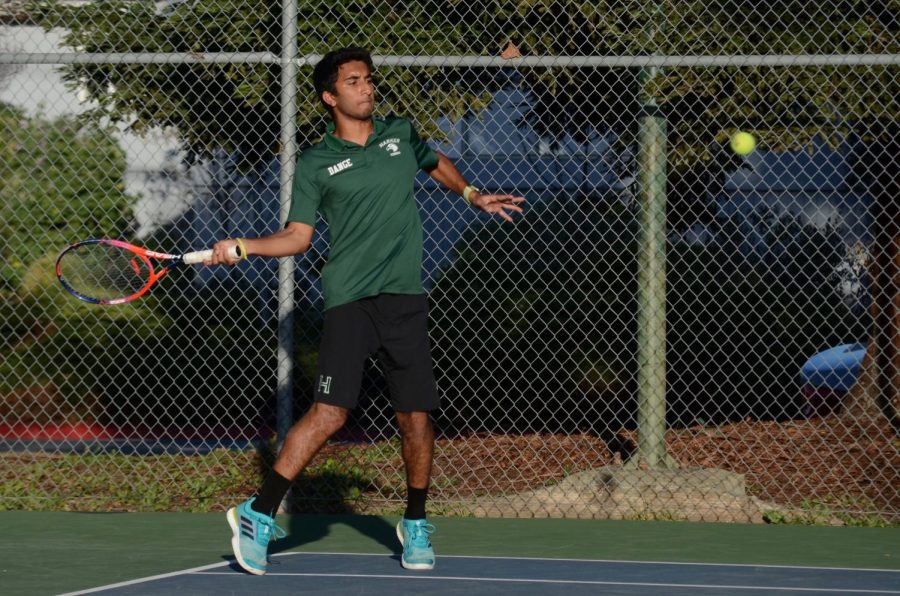 Rishi Dange (12) hits a forehand during a match against Sacred Heart. The Eagles won that match 5-2, and are currently 3-0 on the season.