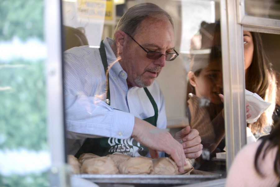 Head of Upper School Butch Keller prepares a biscuit for students after school meeting last week, launching an initiative.