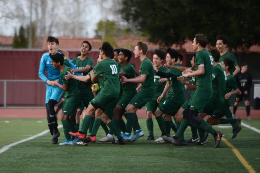 The varsity soccer team celebrates after clinching the CCS championship 3-1 in penalty kicks after ending overtime tied at 1-1. During the penalty kicks, Andrew Cheplyansky (12), Justin Fung (10) and Darshan Chahal (12) all scored, and goalie Laszlo Bollyky (10) made two close saves, securing the win for the Eagles.