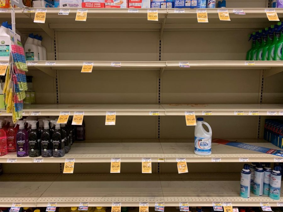 "A shelf for soap, bleach and disinfectant is almost cleared out at a local Safeway.  The shelter-in-place order mandates that individuals must remain in their residence unless performing ""essential"" activities, which include grocery shopping, obtaining healthcare, or performing a job for an ""essential business."