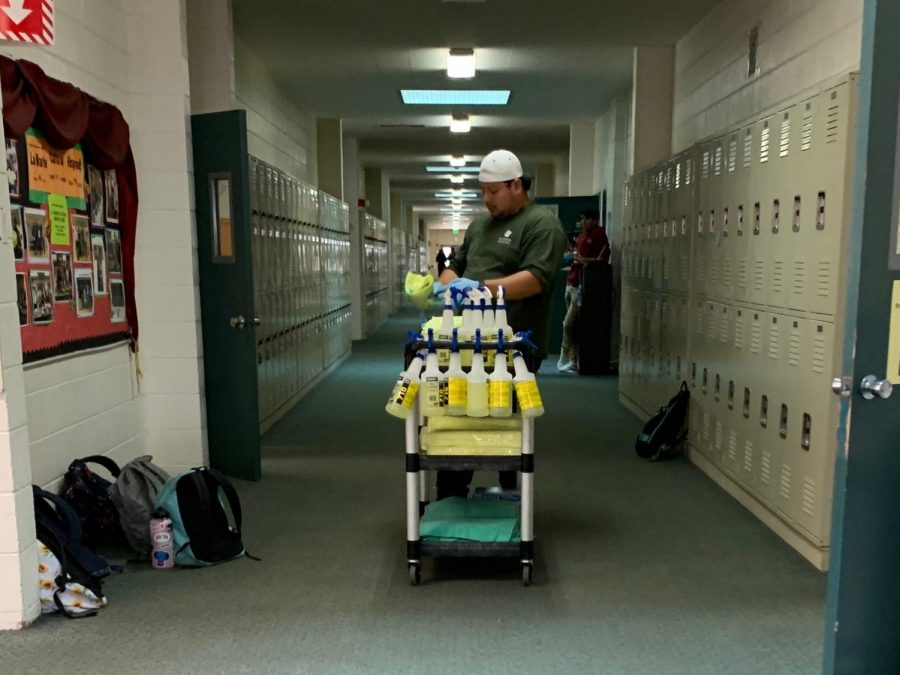 A custodial worker cleans the classrooms in Main after school yesterday. Harker is taking extra precautionary actions to ensure the appropriate sanitation of its campuses.
