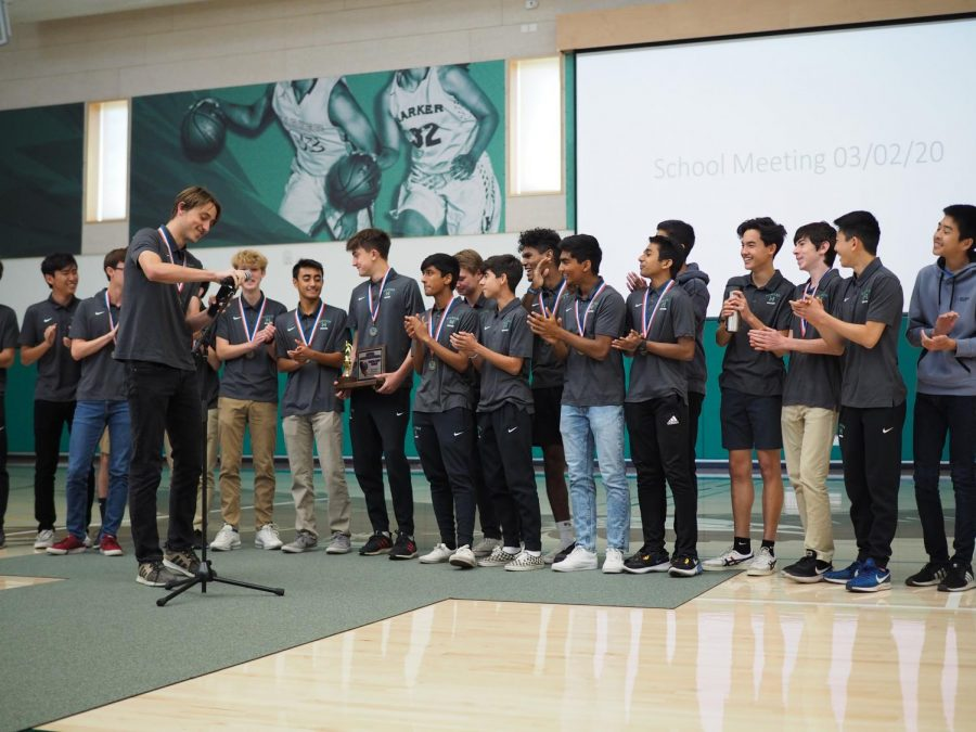 The varsity boys soccer team applauds after senior Andrew Cheplansky finishes speaking about the team's accomplishments this season. The boys won against Saint Francis on Saturday, winning their first CCS championship.