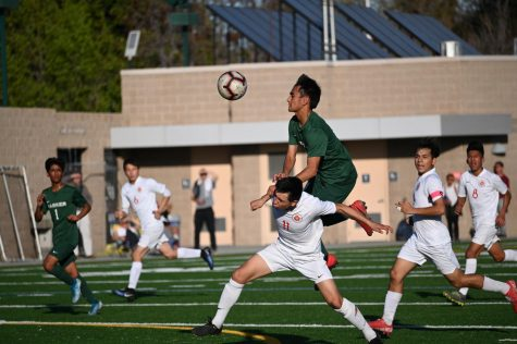Darshan Chahal (12) attempts to head the ball over a Galt player during the boys' NorCal Division III quarterfinal win yesterday. After ending regulation tied at 1-1 and a scoreless overtime period, the boys won 5-4 in penalty kicks.
