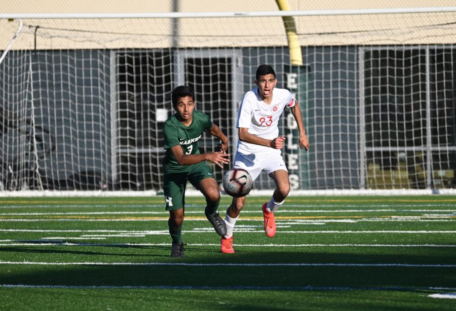 Muthu+Panchanatham+%2810%29+chases+after+the+ball+ahead+of+a+Galt+forward+during+the+varsity+boys%27+NorCal+quarterfinals+matchup+yesterday.+The+Eagles+won+their+third+penalty+shootout+in+three+games%2C+continuing+a+streak+beginning+in+their+3-1+PKs+win+against+Sequoia+in+the+CCS+semifinals.+