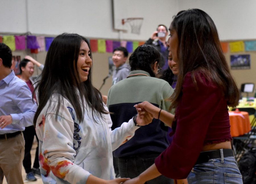 Nerine Uyanik (12) and Simren Gupta (12) dance together during the salsa competition of La Noche Cultural. The salsa competition took place at the end of the night, after  the dinner and student performances.