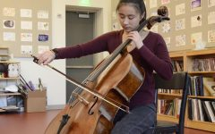 """When I chose to go back to cello and made that decision myself, it was because I actually valued it. [When I'm] practicing by myself, I feel as if I can actually get into the music; it's different because there are no people, [it's] just me and my cello,"" Jackie Yang (12) said."