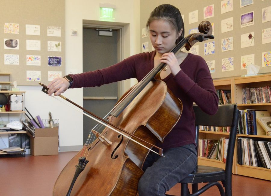 """""""When I chose to go back to cello and made that decision myself, it was because I actually valued it. [When I'm] practicing by myself, I feel as if I can actually get into the music; its different because there are no people, [it's] just me and my cello,"""" Jackie Yang (12) said."""