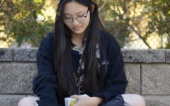"""""""The cards are there to guide you and subconsciously influence what you think of a situation. They're self-evaluative and focused on reflection. Its a great way of manifesting your intentions: [reading the cards] is a reminder to look out and make active choices to put yourself where you need to be,"""" Eva Chang (12) said."""