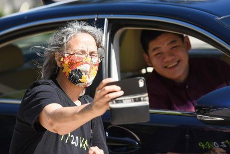 Senior pick-up day celebrates new graduates with drive-thru ceremony