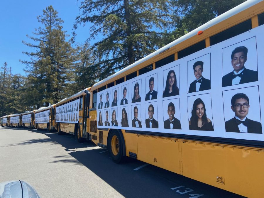 """A row of school buses were decorated with pictures of the seniors. """"There's something about being back on campus, even if it's only for a few minutes and even if it's in our cars, that really made [the drive-thru] special and went a far way to provide some closure to our high school experience,"""" Evan Cheng (20) said."""