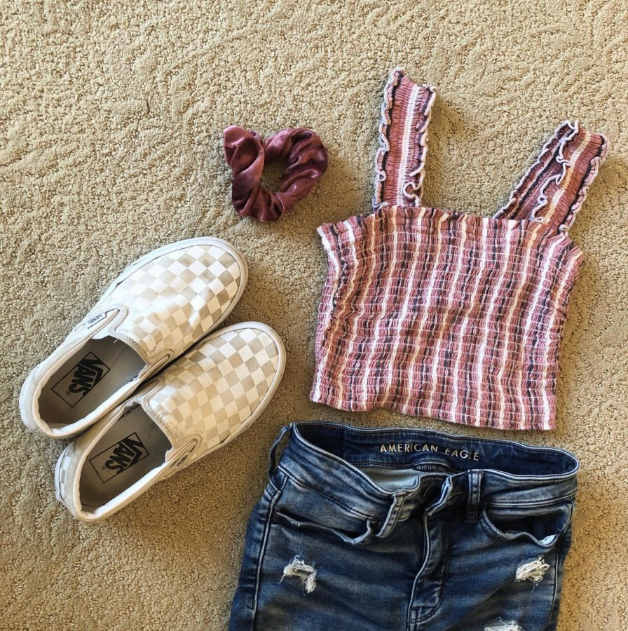 My family got me some new clothes for my birthday, including the striped, pink tank top. I really like the color and the ruffles, and I made an outfit with a pair of American Eagle jeans, a matching scrunchie, and some classic, checkered Vans. It seems like a good