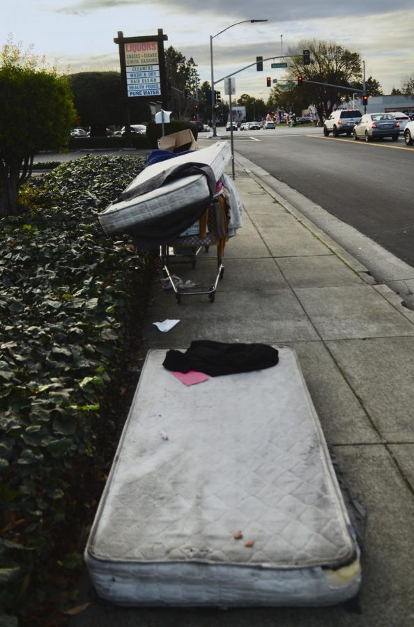 A mattress and a shopping cart full of personal belongings sit on the sidewalk on Kiely Blvd., around the corner from the upper school. According to the latest counts by city officials, in 2019 there were 9,706 people experiencing homelessness in San Jose.