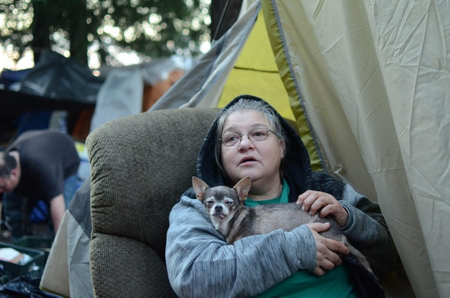 Cina Hone, 49, has lived on the Joe Rodota Trail since August and been unsheltered for 27 years. Most shelters won't let her bring her 12-year-old chihuahua, named Little Mama, with her.