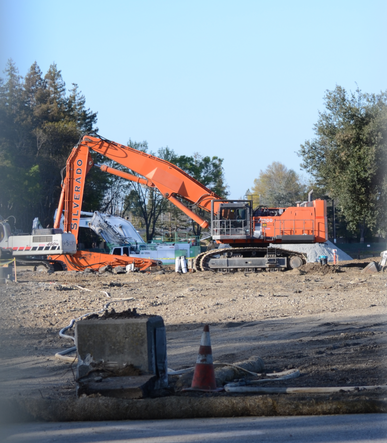 Construction machinery digs up the parking lot of the former Vallco Shopping Mall in Cupertino. On May 7, a judge approved plans to convert Vallco into 2,402 housing units, half of which are below market-rate, and 1.8 million square feet of offices.