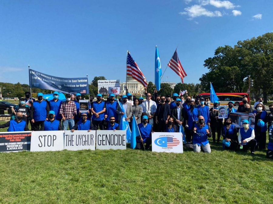 Clad in dark blue shirts, Uyghur protestors gather in Washington D.C. on Oct. 1 on the Global Day of Action. The Chinese government has detained between 1 million and 3 million Uyghurs, a Muslim Turkic minority native to the Xinjiang Uyghur Autonomous Region, also known as East Turkestan, in Northwest China, in over 380 internment camps since 2017.