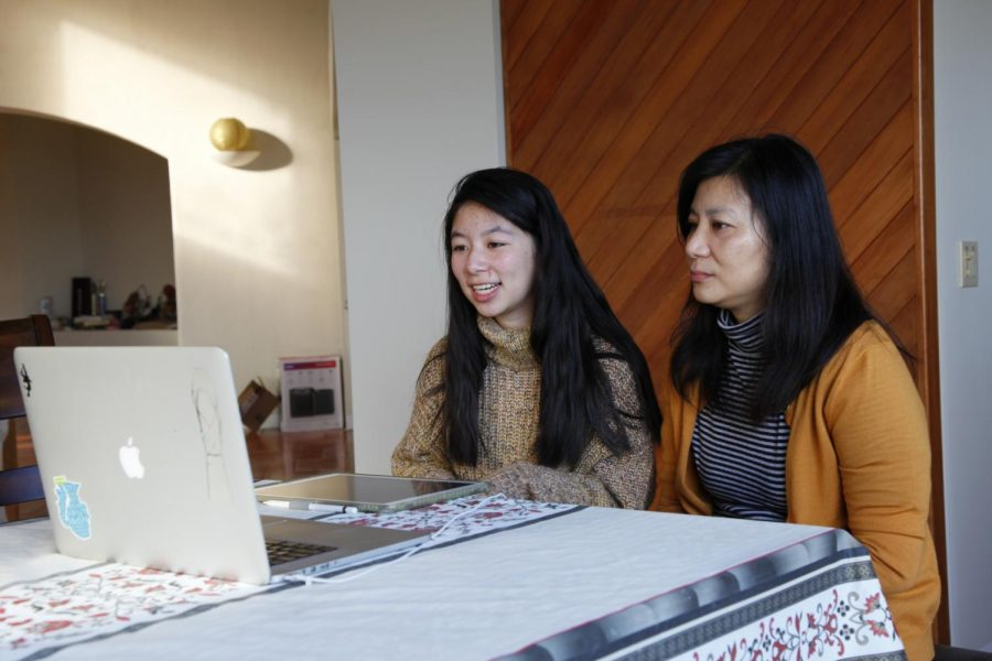 Irene Yuan (11) engages in a parent-teacher-student conference with English teacher Brigid Miller on Friday, Nov. 20.  This year, conferences took place over the platform Meet the Teacher.