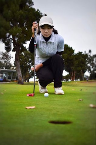 Claire Chen (10) intently examines the target hole before her shot. Last year, Claire finished 3rd in CCS and 5th in NorCal for girls golf.