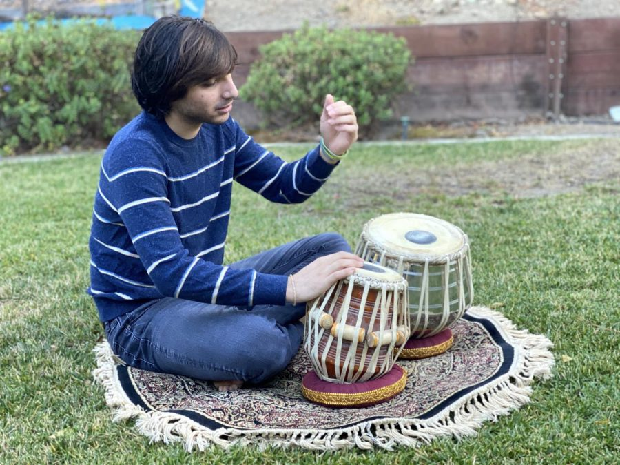 """I got to a certain place where … you start to really feel empathy with [tabla], and you just enjoy playing and enjoy the speed. I felt like [the instrument] was trapped in this box of classical Indian music … But listening to the songs I listen to every day, I would start drumming in my lap, and at that point, I thought, 'This isn't out of place,'"" Nicky Kriplani (12) said."
