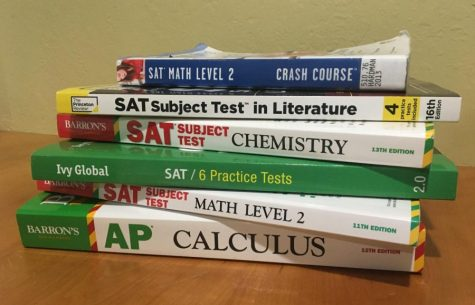 A stack of SAT-prep books. The College Board announced that administration of SAT Subject Tests and the optional SAT Essay would be eliminated on Tuesday.
