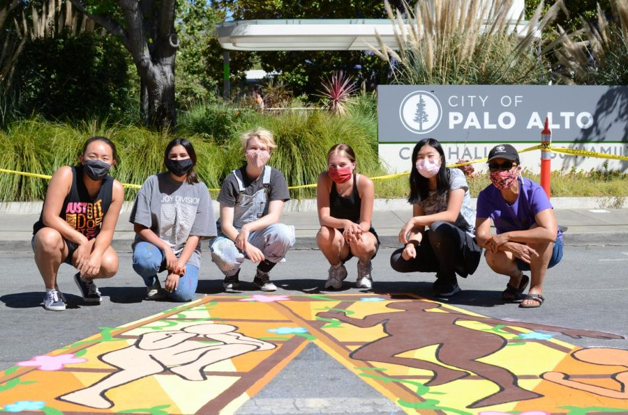 Members of the upper school Art Club stand behind their artwork, part of a Black Lives Matter street mural organized in Palo Alto on June 30.