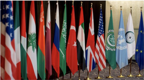 "Flags of different countries stand outside a 2016 meeting of the International Syria Support Group. ""I think we can all come together and agree that Biden"