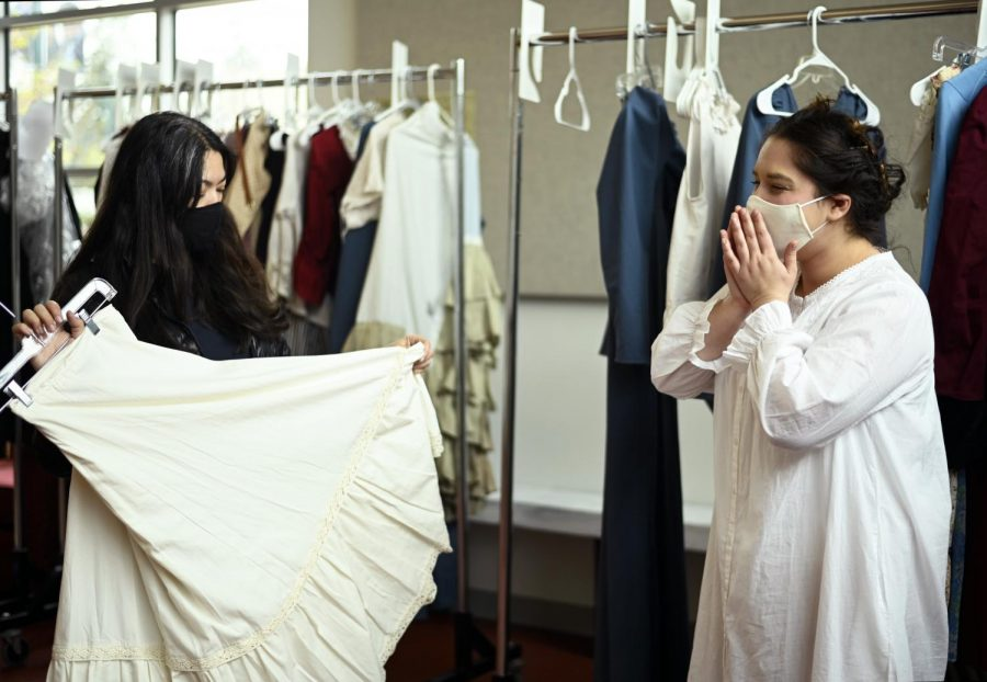 Costume designer Caela Fuiji and Ruya Ozveren (12) look over the costumes before Ruya goes onstage. Ruya plays the role of Fantine in