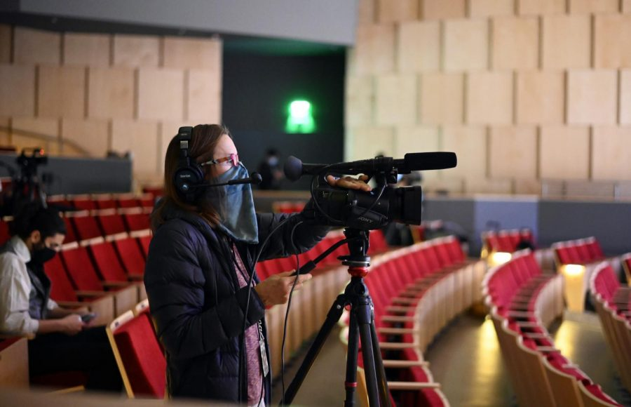Camera operator Jenny Miller wears a mask while filming on the last rehearsal day of the musical. This year's musical was filmed in a movie format.