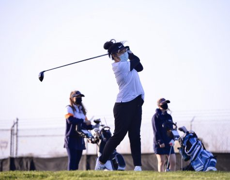 Natalie Vo (12) hits a tee shot with her driver during the girls golf team