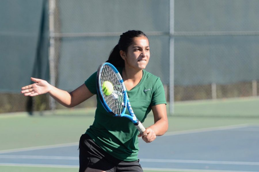 Anushka Mehrotra (10) swings at a ball during the team's CCS semifinals' matchup against St. Francis last school year. Girls tennis resumed three weeks ago, and since then, the team has racked up three victories, against Monta Vista, Sacred Heart, and now, Menlo.