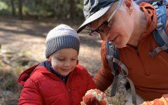 Upper school Latin teacher Scott Paterson shows his son, Virgil, holding some Amanita Muscaria mushrooms in Jan. 2020.
