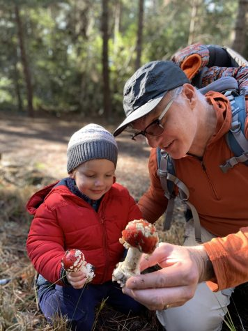Upper school Latin teacher Scott Paterson shows his son, Virgil, holding some Amanita Muscaria mushrooms in Jan. 2020.