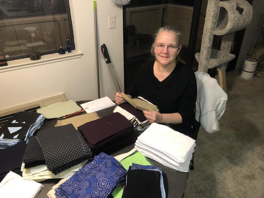 Library director Lauri Vaughan stacks rectangles of cotton into what she calls