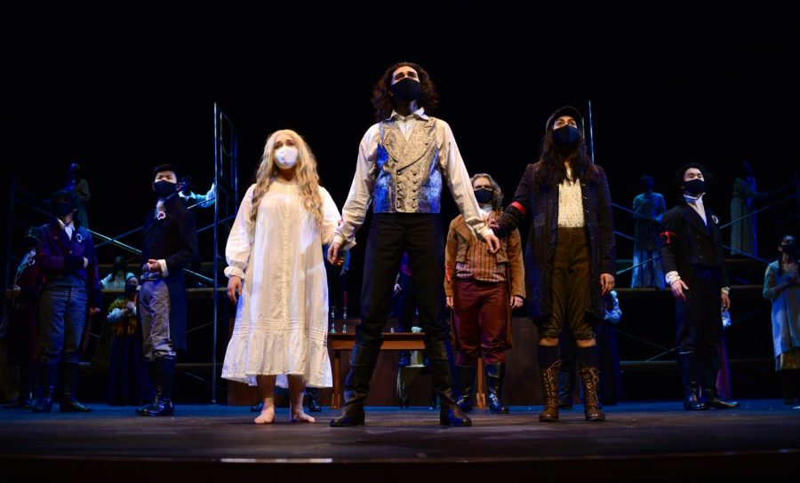 Seniors Ruya Ozveren, Alex Kumar, and Vaishnavi Murari sing in the closing scene of the spring musical Les Misérables with the entire cast on March 19. Unlike the format of the Fall Play and Student Directed Showcase (SDS), Performing Arts Director Laura Lang-Ree converted the musical into a movie, where multiple video angles are used and the audio is recorded beforehand.