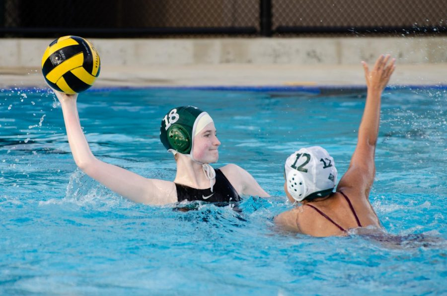 Elizabeth Fields (12) passes the ball to a teammate in the water polo team's match against Homestead. The team will face off next at home against Mountain View at 3:30 P.M. on April 27.