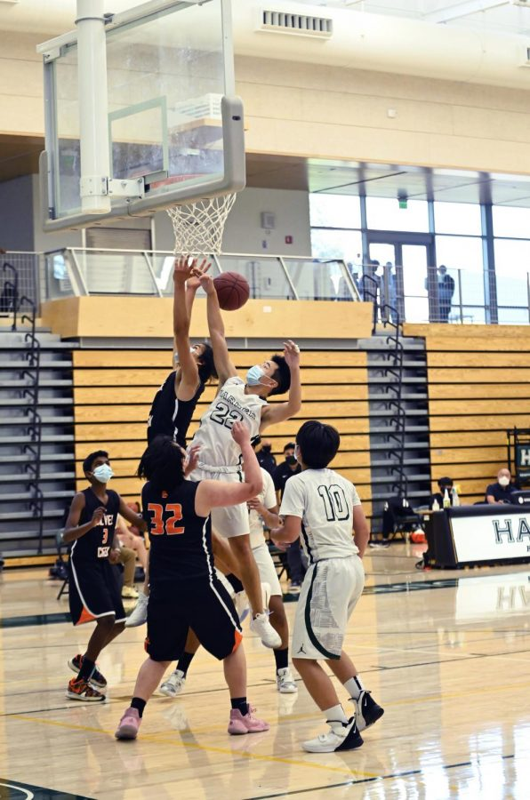 A junior varsity member leaps to make a rebound during the team's match against Silver Creek High School on April 15. The boys will face off next against Pinewood School in an away game on April 27 at 4:30 p.m.