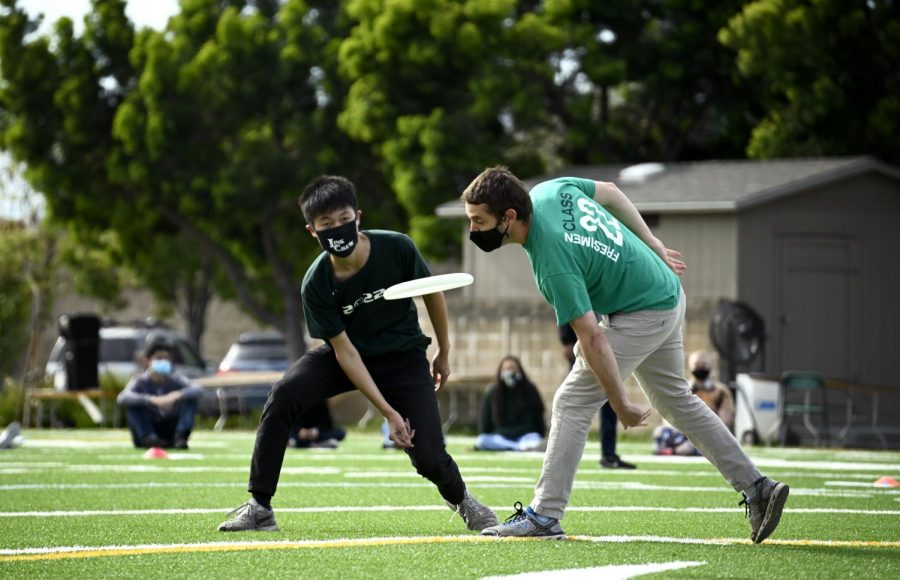 Junior Dawson Chen and junior advisor Samuel Lepler play in the final round of the juniors' game of ultimate frisbee. The game occurred during the morning spirit activity block before the juniors split into advisory groups.