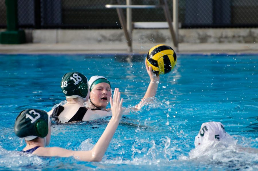 A member of the varsity girls water polo team passes the ball to a teammate during the team's match against Homestead on April 20. The team's next match is against Los Gatos at home at 4:30 p.m. on Tuesday.