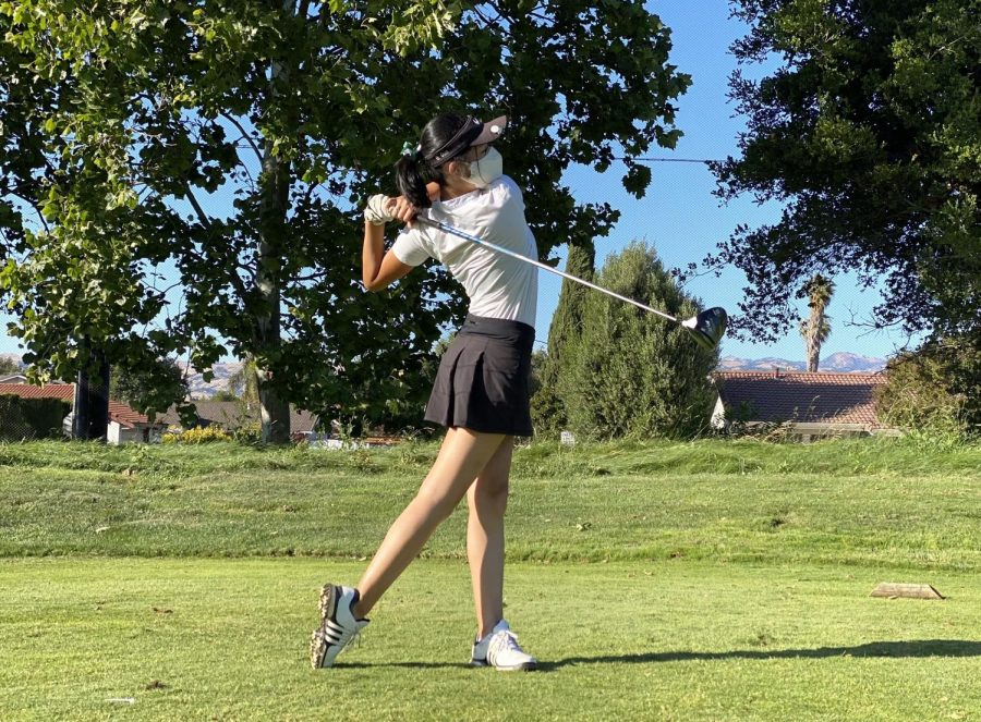 Olivia Guo (12) swings her club during the girls golf teams Senior Night on June 10. The boys and girls golf teams both won CCS Championships last week.