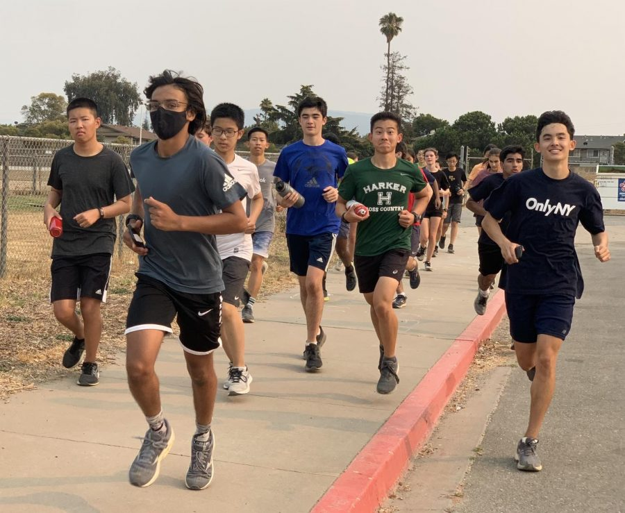 The cross country team runs together during practice at Vasona Park on Aug. 19.