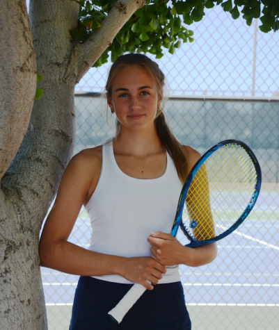 Emily Novikov (11) poses outside the Blackford Campus tennis courts with her Yonex Ezone 98  tennis racket. Emily helped lead the varsity girls tennis team to a CCS Championship in her sophomore year.
