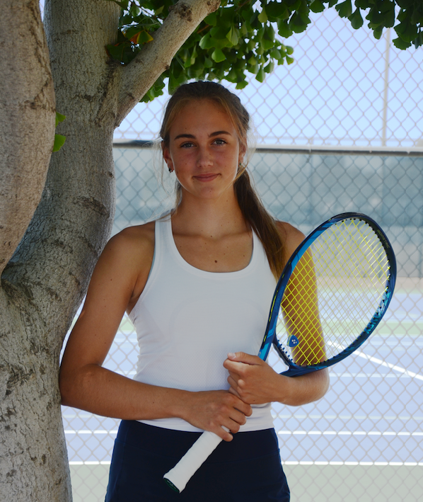 Emily+Novikov+%2811%29+poses+outside+the+Blackford+Campus+tennis+courts+with+her+Yonex+Ezone+98++tennis+racket.+Emily+helped+lead+the+varsity+girls+tennis+team+to+a+CCS+Championship+in+her+sophomore+year.