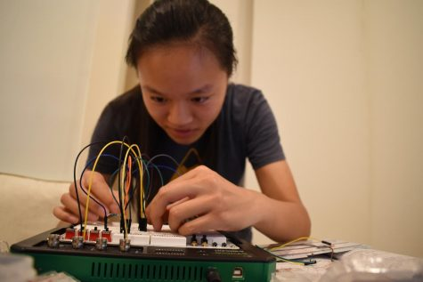 Teresa Cai (12) tinkers with circuits as part of her work in the Research in Science and Engineering (RISE) program at Boston University. Interns collaborated virtually with their mentors and presented their research at the end of the 6-week-long program.