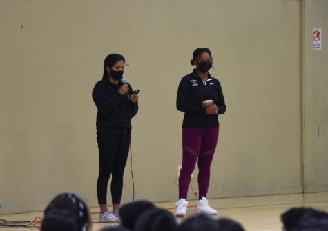 """Student Diversity Coalition representatives Uma Iyer (12) and Brooklyn Cicero (12) introduce Challenge Day on Friday. """"[Challenge Day] was truly a transformative experience,"""" Brooklyn said in her speech. """"It brought me a lot closer to my peers and allowed me to get very vulnerable with them, something that was a bit hard to do at first, but eventually I got used to it."""""""