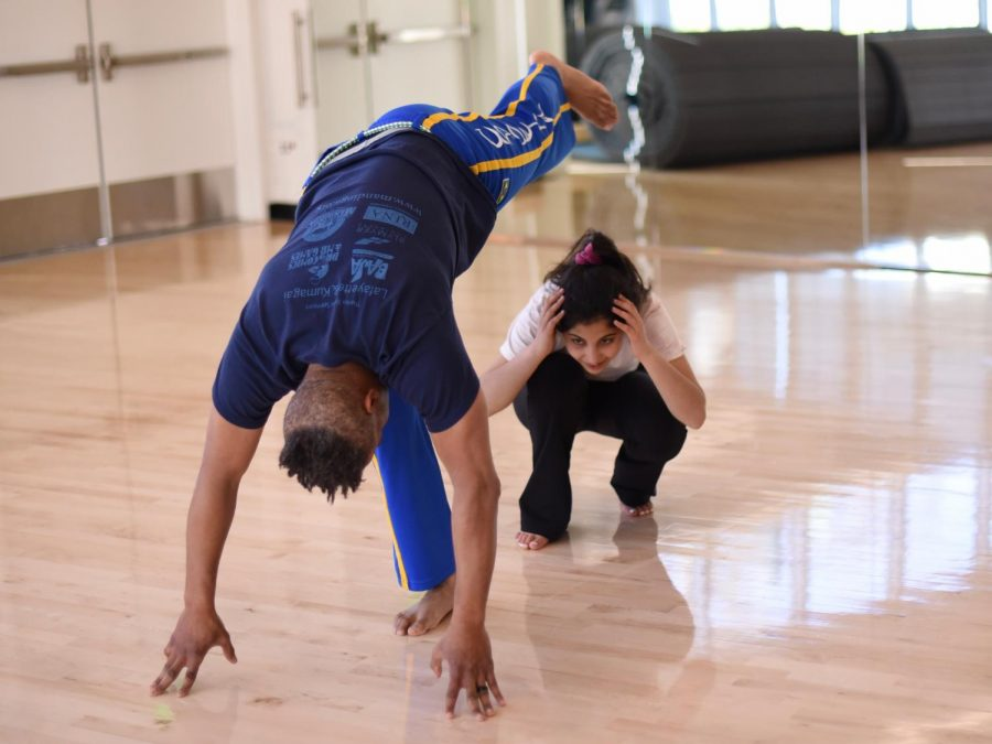 Instructor Loren Due and Melody Yazdi (12) practice a move during a capoeira session in April 2019. In addition to capoeira, after school PE class offerings include fencing, yoga, fitness for life, and after school fitness.